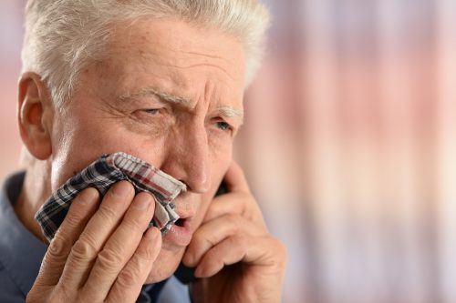 man with toothache calling emergency dentist