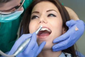 woman receiving dental cleaning